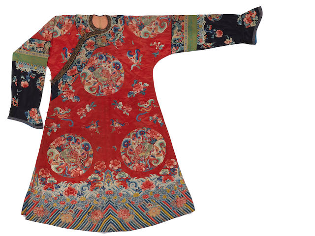 A woman's red silk ground embroidered informal robe Late Qing dynasty