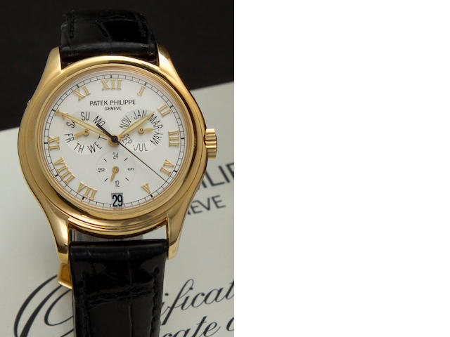 Patek Philippe. A fine 18K gold automatic center seconds wristwatch with annual calendarRef: 5035J, Case No. 4026332, Movement No. 3057769, sold in 1998