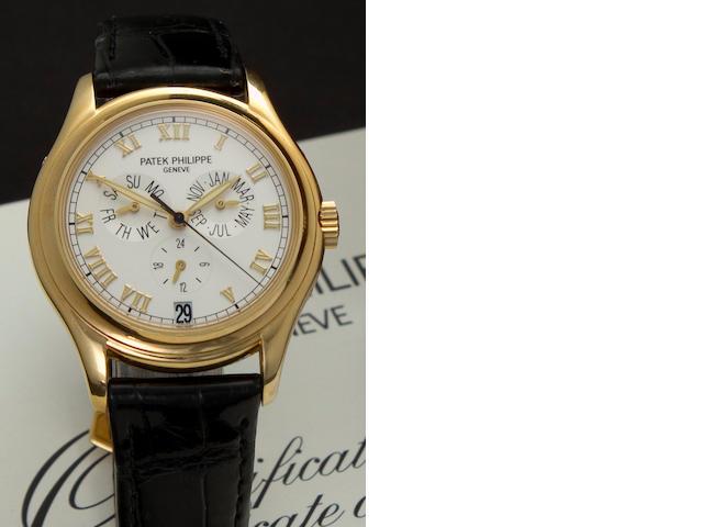 Patek Philippe. A fine 18K gold automatic center seconds wristwatch with annual calendarRef: 5035J, Case No. 4026332, Movement No. 3057769, sold in 1998