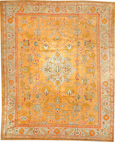 An Oushak carpet West Anatolia size approximately 10ft. 3in. x 12ft. 7in.