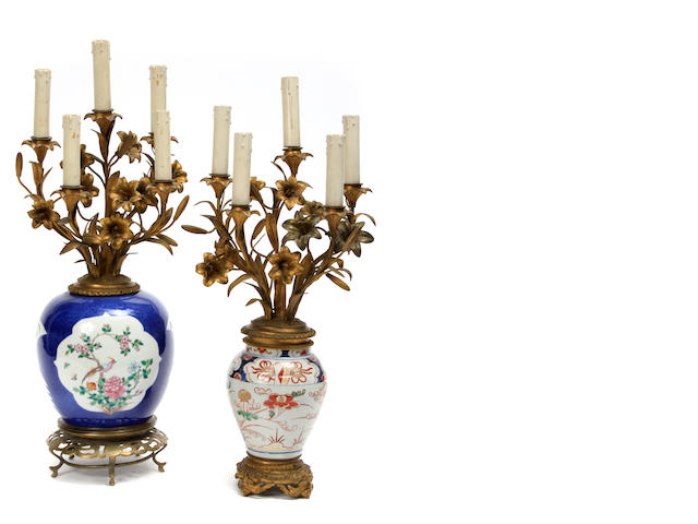 Two Chinese gilt metal mounted porcelain candelabra