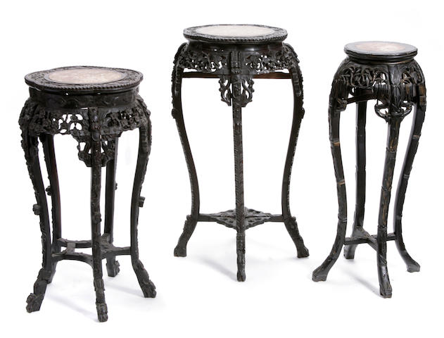 A group of three Chinese carved hardwood pedestals