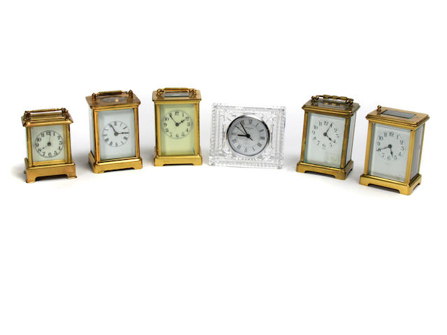 A group of five gilt brass carriage timepieces