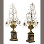 A pair of Empire style gilt and patinated metal and glass two light girandoles