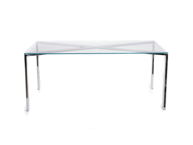A Phase Design polished stainless steel and smoked glass dining table
