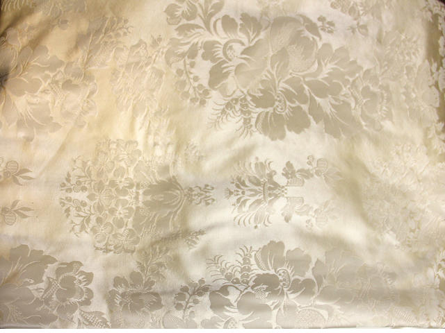 A group of cream damask silk drapes