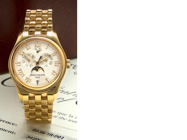 Patek Philippe. A fine 18K rose gold center seconds automatic bracelet watch with annual calendar, moon phase and power reserveRef:5036/1R – 001, Case no. 4292309, Movement no. 3420074, sold 2005
