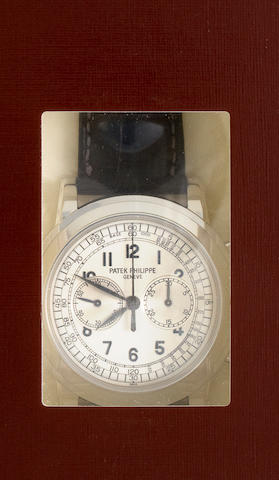 Patek Philippe. A very fine 18K white gold chronograph wristwatchRef:5070G-001, Case no. 4374950, Movement no. 3362939, completed 2006