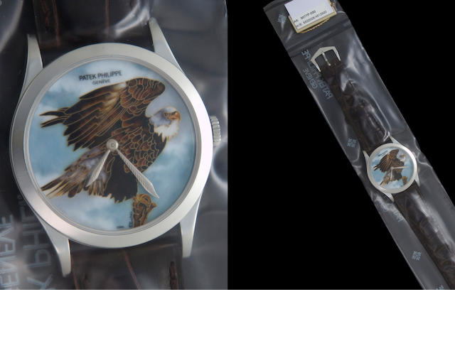 Patek Philippe. A very fine platinum automatic wristwatch with painted and cloisonné enamel dial depicting the American bald eagleRef:5077P - 030, Case no. 4512500, Movement no. 5320028,  dial signed by the enameller, A. Porchet, sold 2011