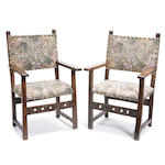 A pair of Spanish Baroque walnut open armchairs