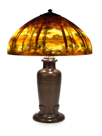 A Handel reverse-painted glass and patinated-metal Scenic Tropical Island table lamp model #6281, circa 1914