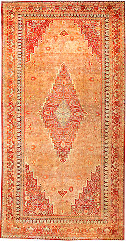 A Khotan carpet  Turkestan size approximately 9ft. 3in. x 18ft.