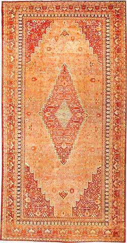 A Khotan carpet  Turkestan size approximately 9ft. 3in. x 18ft.