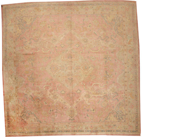 An Oushak carpet  West Anatolia size approximately 13ft. 6in. x 13ft. 8in.