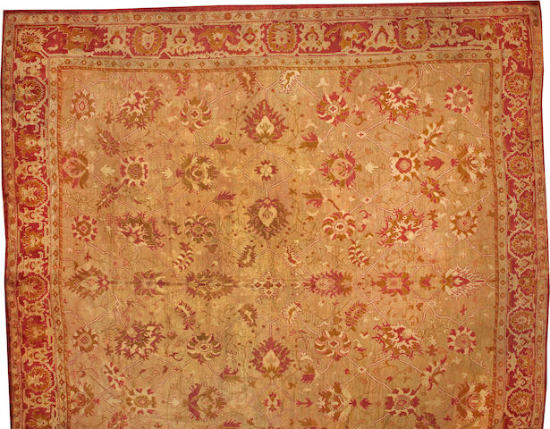An Oushak carpet West Anatolia size approximately 18ft. 5in. x 19ft.