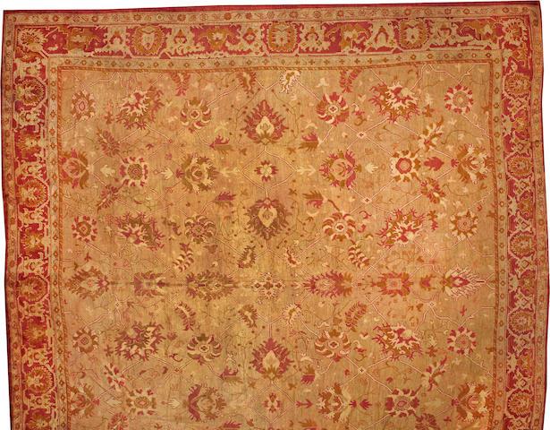 An Oushak carpet  West Anatolia size approximately 18ft. 5in. x 19ft.