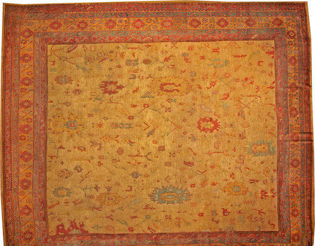 An Oushak runner  West Anatolia size approximately 16ft. 6in. x 19ft.