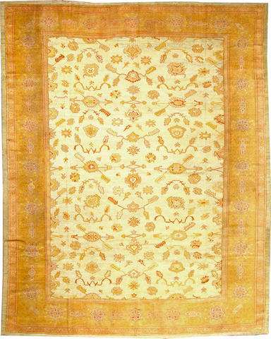 An Oushak carpet  West Anatolia size approximately 12ft. 3in. x 15ft. 6in.
