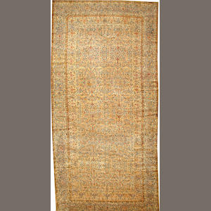 A Kerman carpet  South Central Persia size approximately 10ft. 8in. x 22ft.