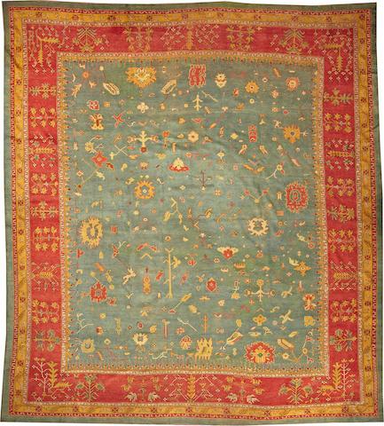 An Oushak carpet West Anatolia size approximately 12ft. 3in. x 14ft.