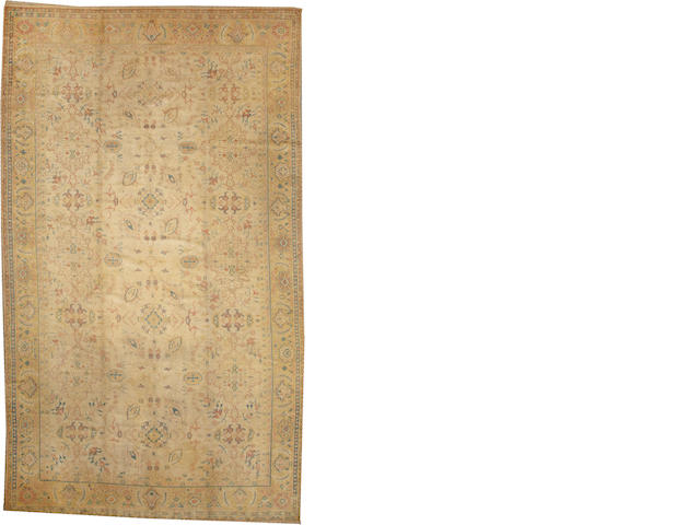 An Oushak carpet  West Anatolia size approximately 9ft. 5in. x 15ft. 8in.