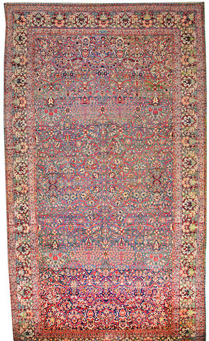 A Lavar Kerman Carpet  Central Persia size approximately 12ft. 1in. x 21ft. 10in.