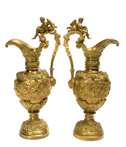 A pair of Renaissance style gilt bronze ewers