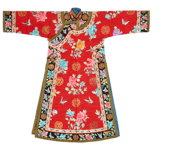 A Manchu noblewoman's embroidered red silk informal robe, changyi Late Qing dynasty
