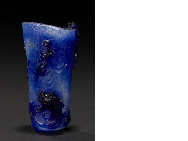 A blue and snowflake glass libation cup  18th century