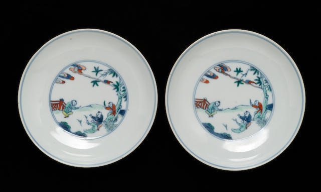 A pair of small doucai-decorated porcelain dishes with 'One Hundred Children at Play' Chenghua marks, 18th century