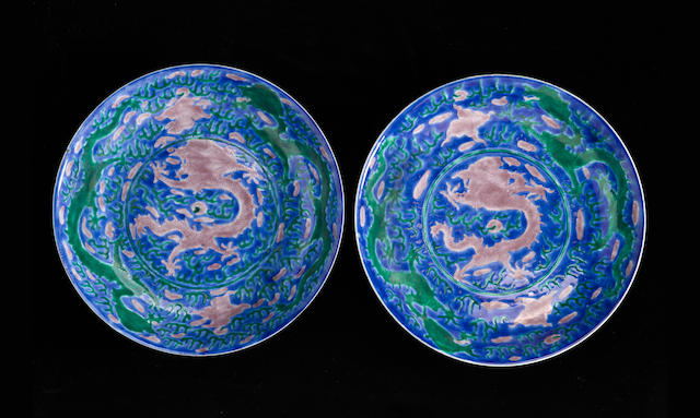 A pair of blue ground porcelain dragon dishes Kangxi mark and period