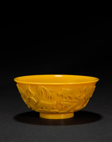 An opaque yellow glass bowl with animal decoration  19th century