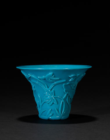 An opaque turquoise blue glass libation cup with lotus decoration   19th century