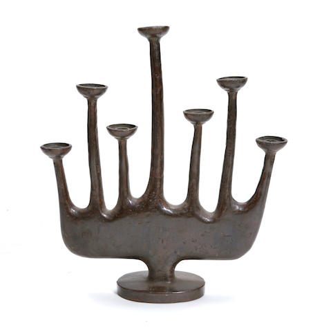A Contemporary patinated bronze seven light candelabrum