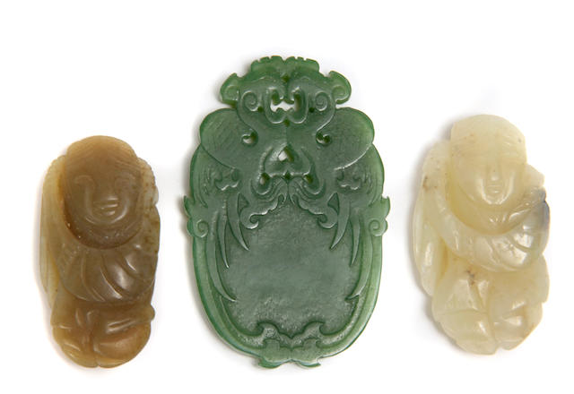A group of three jade pendants