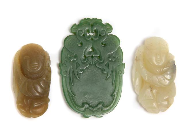 A group of three jade pendants