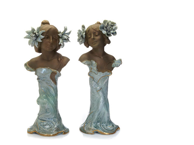 A pair of Ernst Wallis glazed ceramic female busts circa 1900