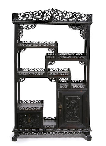 A Chinese carved hardwood side cabinet