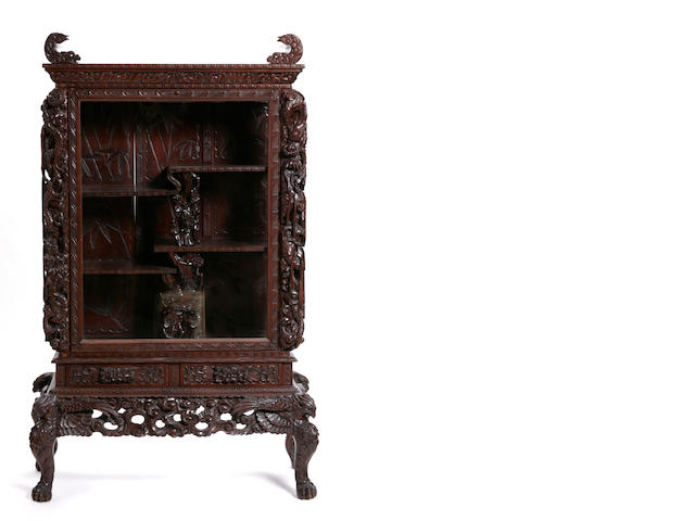 A Chinese carved hardwood cabinet on stand