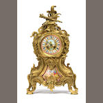A Louis XV style gilt bronze and porcelain mounted enameled clock