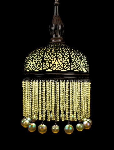 An early Tiffany Studios Favrile glass and bronze wirework chandelier  circa 1900