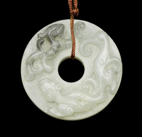 A good white nephrite disk, bi Late 18th/early 19th century