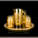 Seven René Lalique molded amber glass  lemonade table articles: Bahia, and a complementary René Lalique molded amber glass tray: Jaffa  Marcilac 3683 and 3680 respectively, models introduced 1931