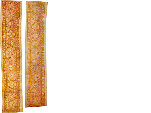 A pair of Oushak runners West Anatolia size approximately 3ft. x 14ft. 8in. and size approximately 2ft. 5in. x 13ft.