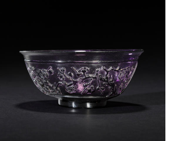 A transparent deep purple glass bowl  19th century