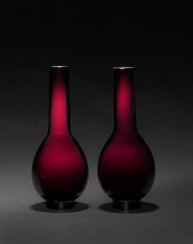 A pair of unusual plum color long-neck bottle vases  18th century