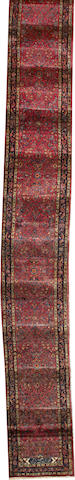 A Sarouk runner Central Persia size approximately 2ft. 5in. x 22ft. 7in.