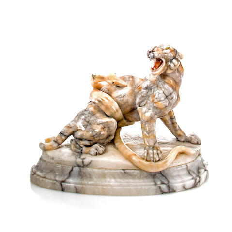 A variegated marble sculpture of a tiger and a boa constrictor engaged in mortal combat<BR />20th century