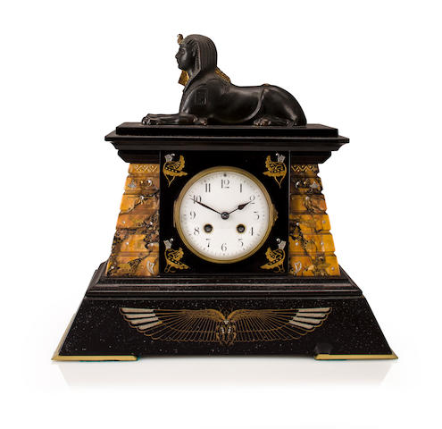 A French Art Deco patinated bronze, black granite and variegated marble Egyptian style mantel clock<BR />second quarter 20th century