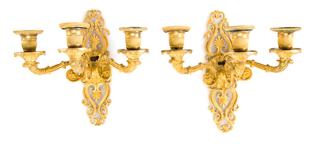 A pair of Restauration style gilt bronze three-light wall appliques<BR />second half 19th century